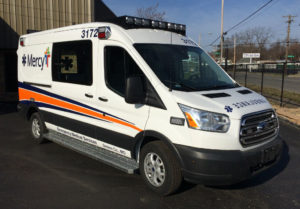 Ford Transit Type II Midroof with Mercy Hospital decals